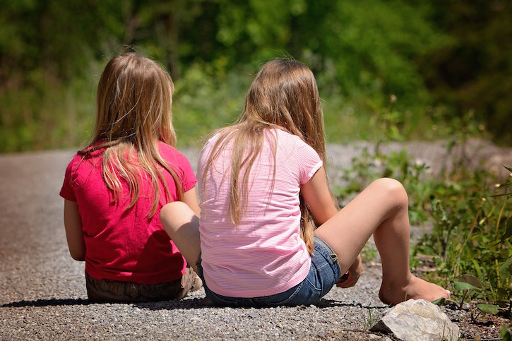 Two Blonde Girls on Sidewalk