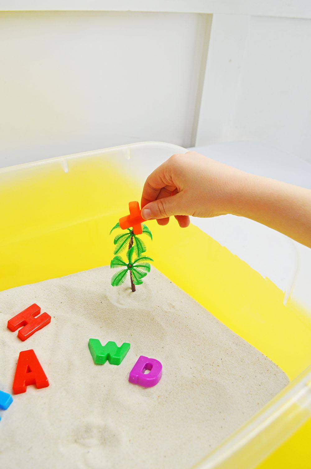 Child's Hands in Sensory Bin