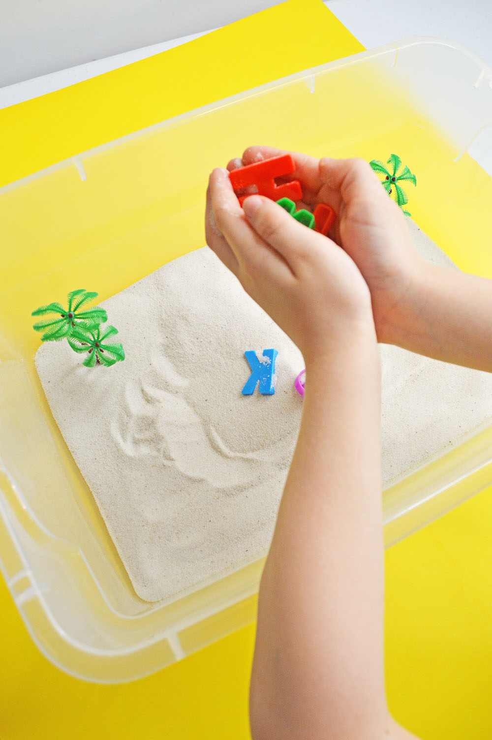 Child's Hands Playing in Sensory Bin