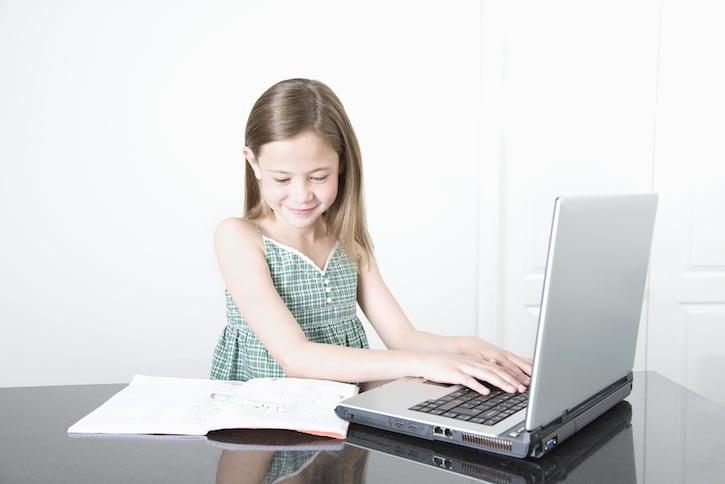 Girl Doing Homework on Laptop Computer