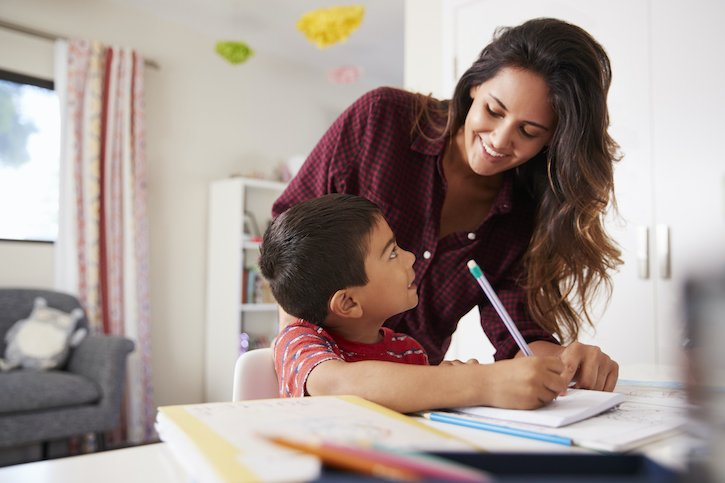 Mother Homeschooling Son - Hispanic