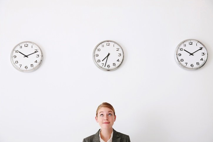 white woman woman looking at office clock