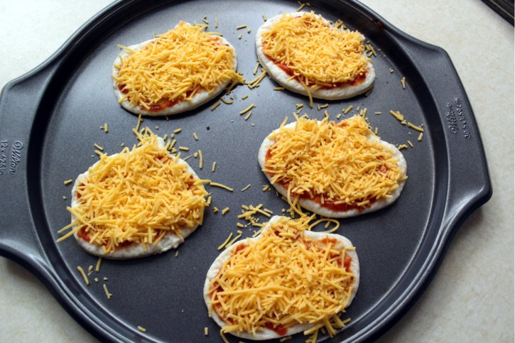 Pumpkin pizzas with cheddar cheese