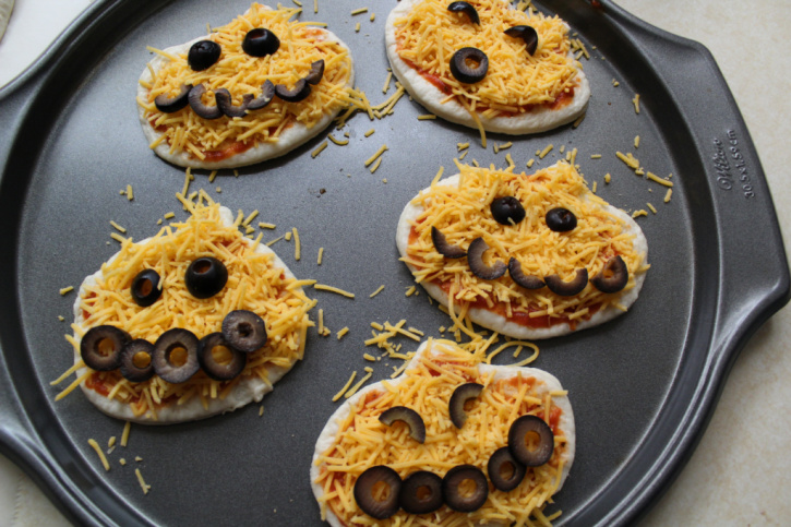 pumpkin pizzas with black olives