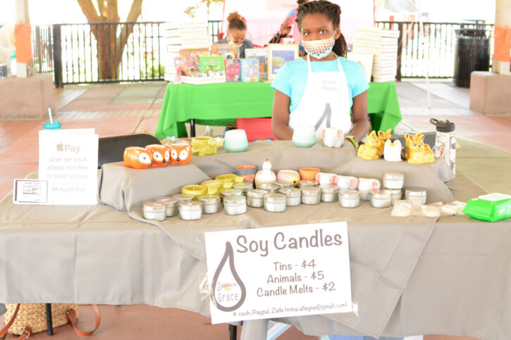 Girl with Face Mask Selling Soy Candles at Acton Children's Business Fair