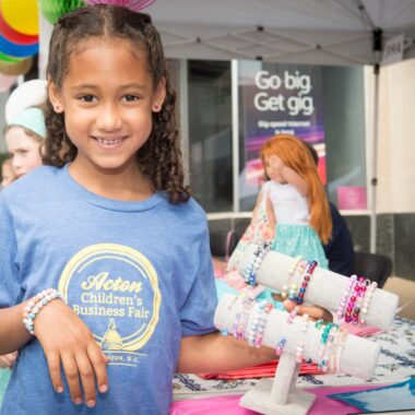 Girl Selling Jewelry at Acton Children's Business Fair