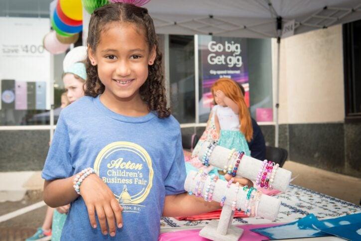 Girl Selling Bracelets at Acton Children's Business Fair