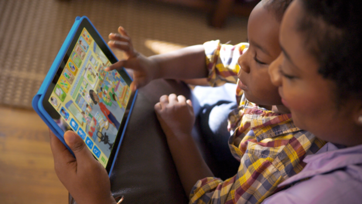 parent and child working with ABCmouse on tablet