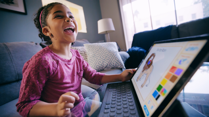 girl working with ABCmouse on tablet
